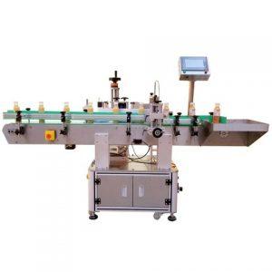 Stroj na etiketovanie fliaš ružového esenciálneho oleja