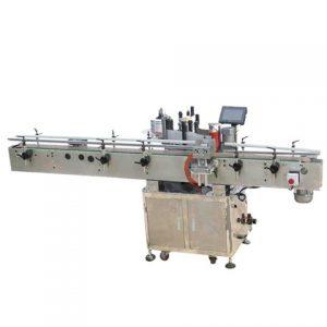 Stroj na označovanie pastových plechoviek