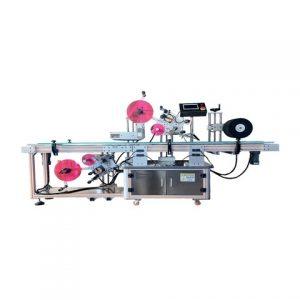 Stroj na označovanie okrúhlych balzamov na pery